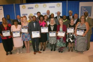 The 2015 Roanoke Valley Community Champion Awards nominees show off their plaques during a ceremony in their honor Tuesday night at The Centre at Halifax Community College in Weldon. – Tia Bedwell | The Daily Herald
