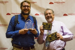 NI reporter Murphy Woodhouse, left, holds up his Photographer of the Year award and Publisher Manuel Coppola shows off first-place recognitions for Best Use of Photography and Best News Story.