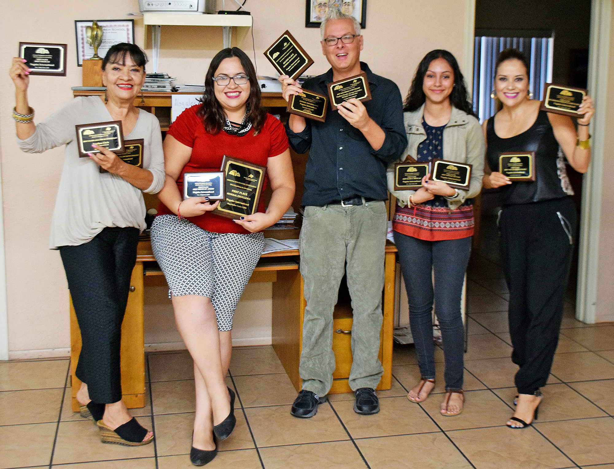 The Nogales International was recognized for excellence in editorial content, design and advertising at the 2016 Arizona Newspapers Association awards ceremony. From left: Advertising representative Marilla Castillo, graphic designer Priscilla Bolanos, managing editor Jonathan Clark, reporter Paulina Pineda and advertising representative Carmen Ibarra.