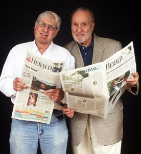 MARK.LEVY@SVHERALD.COM Bob, left, and Walt Wick peruse an issue of the Sierra Vista Herald in this photo taken in September of last year.